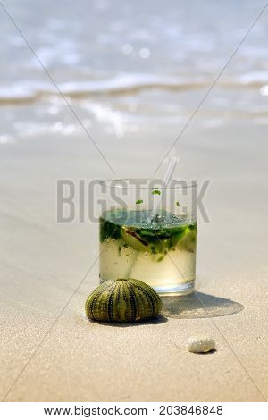 Detail Of Mojito Drink With Seashell In Sand. Sunny Day At Montego Bay Beach, Jamaica