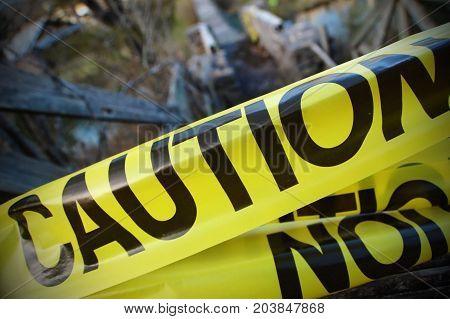 Caution tape forbidding access across a mysterious bridge.