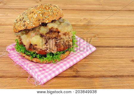 Hog roast meat sandwich in a seed covered bread roll