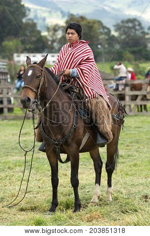 June 3 2017 Machachi Ecuador: Andean cowboy on horseback wearing chaps and poncho