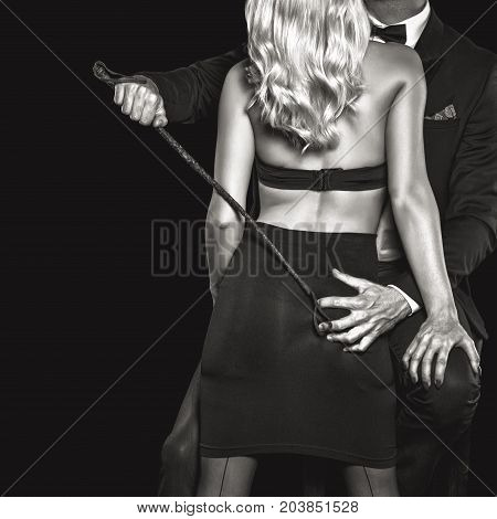 Rich man playing with blonde lover by whip bdsm black and white