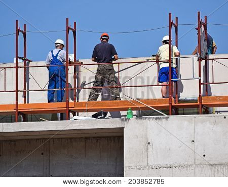 Construction workers at work outdoor in summer