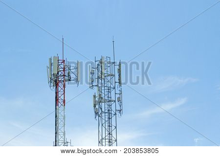 Mobile phone communication two tower transmission signal with blue sky background