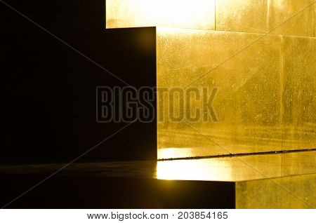 Golden marble pyramid steps on unknown soldier memorial monument at sunset, mountain Avala near Belgrade, Serbia
