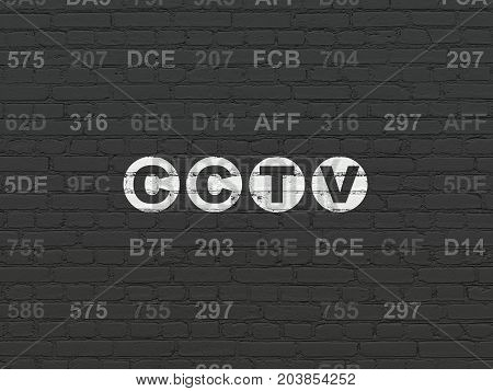 Protection concept: Painted white text CCTV on Black Brick wall background with Hexadecimal Code