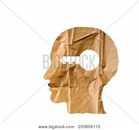 Crumpled paper shaped as a human head and key on white background. Safety and secrets concept.