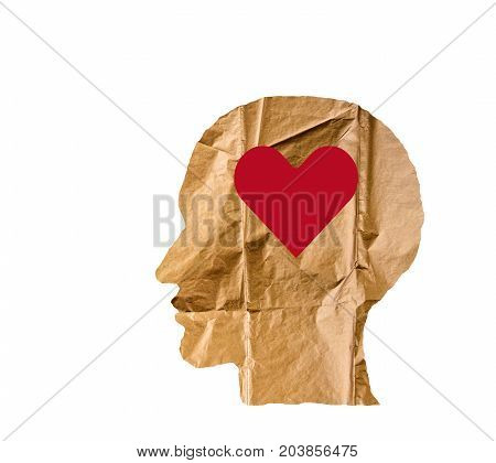 Crumpled paper shaped as a human head and heart on white background. Love concept.