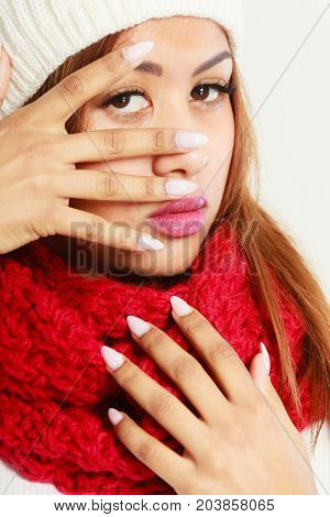 Mulatto Woman In Warm Winter Clothing Showing Nails