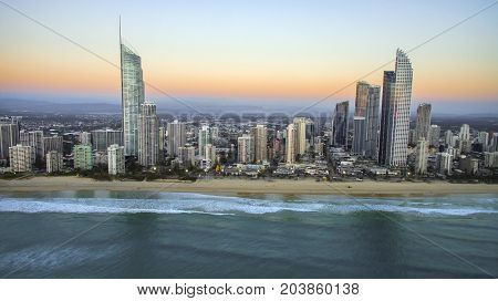 GOLD COAST, AUSTRALIA - SEPTEMBER 3 2017: Aerial view looking towards Surfers Paradise cityscape and famous beach, with sunrise colours in the sky
