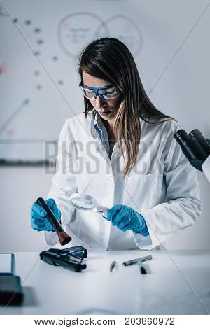 Forensic Scientist Working In Her Lab. Toned Image.