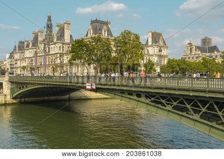 View with Hotel-de-Ville Paris City Hall building seen from the bridge on August 26 2017 in Paris France.