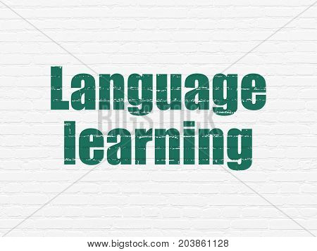 Learning concept: Painted green text Language Learning on White Brick wall background