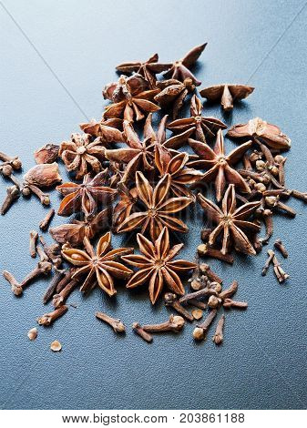 Anise stars and cloves on the black. Shallow dof.