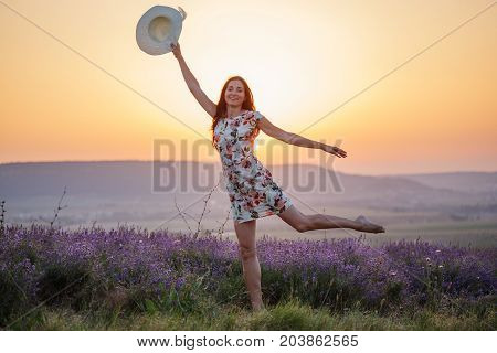 Smiling Woman Posing On One Leg On Lavender Sunset