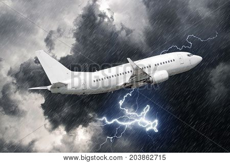 White passenger airplane takes off during a thunderstorm lightning strike of rain bad weather