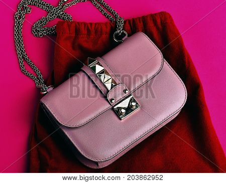 Small Womans Leather Pink Bag With Red Skirt