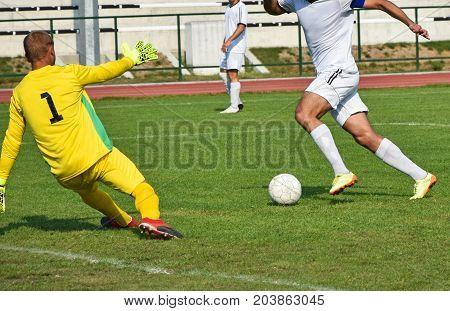 Soccer playar kicks a goal on a match