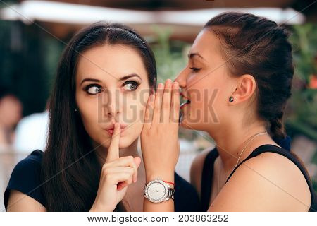 Indiscrete Gossiping Girl Telling Secrets to her Surprised Friend