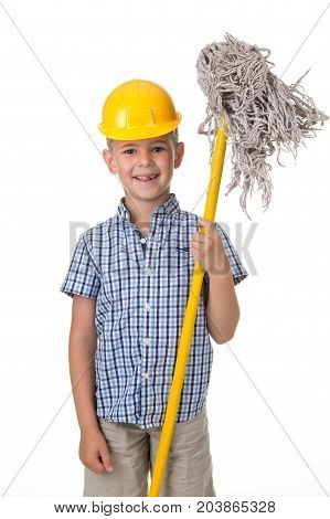 A cute boy in a yellow helmet with a mop. Little helper