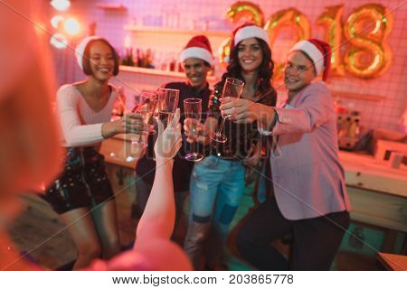 Multiethnic Friends Clinking Glasses Of Champagne
