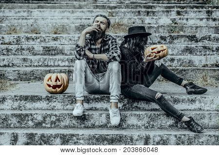 Halloween Man And Woman With Pumpkins