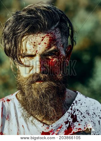 Halloween Hipster With Red Blood Splatters On Bearded Face