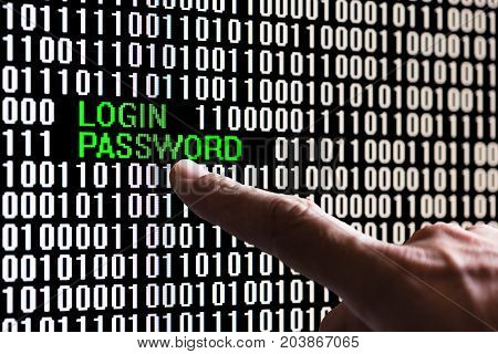 Finger pointing login password in binary code on a computer screen
