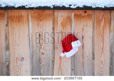 Santa Claus Hat On Snowy Fence