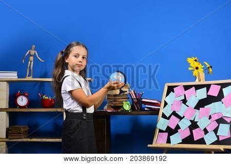 Schoolgirl With Proud Face Holds Little Globe In Her Hands