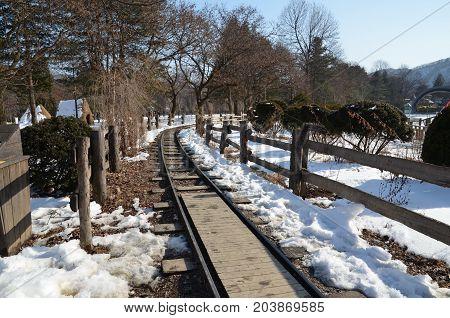 Railway n the Nami Island, Seoul Korea. In winter season all around the Island filled of snow and ice