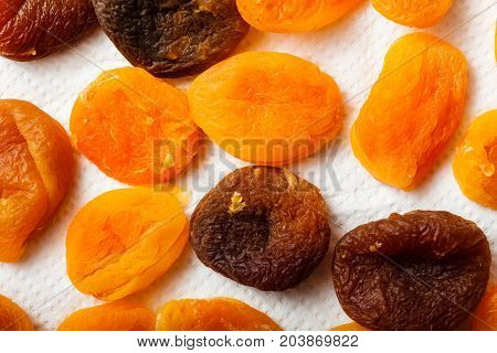 Food concept. Detailed closeup of dried apricots in different shades of orange