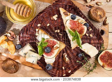 Overhead Of Figs, Dried Figs, Snack Sandviches With Brie, Blue Cheese, Fig Slices, Pine Nuts,  Blueb
