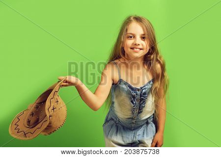 Girl In Fancy Outfit Holds Cowboy Hat.