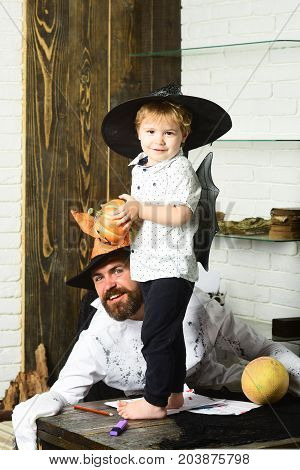 Halloween And Party Concept. Witcher And Little Magician