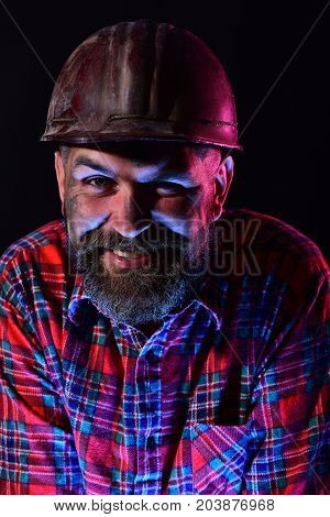 Worker With Brutal Image Wears Dirty Helmet And Plaid Shirt