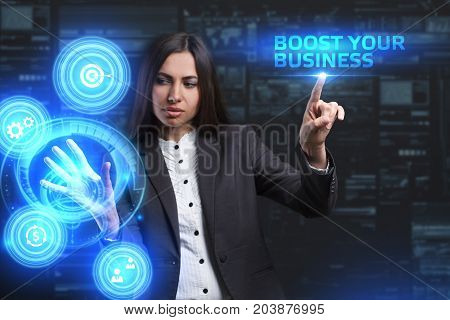 The concept of business technology the Internet and the network. A young entrepreneur working on a virtual screen of the future and sees the inscription: Boost your business