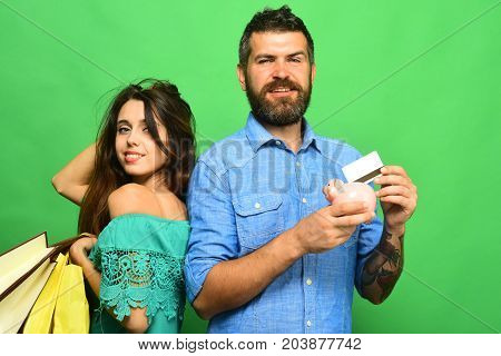 Shopping And Spending Concept. Guy With Beard And Lady