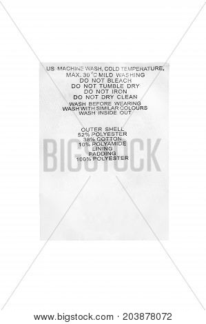 Fabric composition and washing instructions clothes label isolated over white