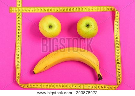 Face With Sad Expression Made Of Fruit: Banana And Apples
