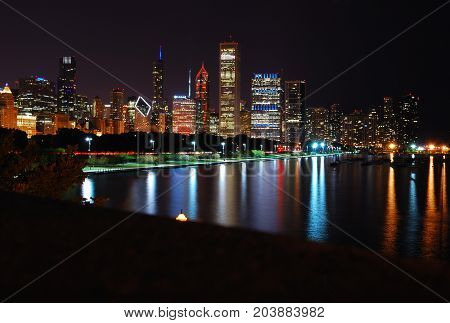 A Chicago night skyline across Lake Michigan.