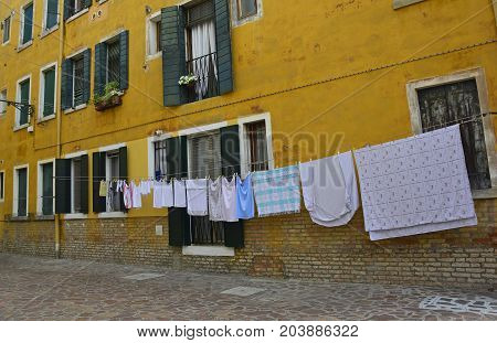 Venice, Italy - July 26th 2017. A residential area in the Dorsoduro quarter of Venice. Despite it being peak season, the more residential back streets remain relatively quiet