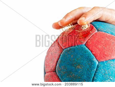 Close up of excess use of handball resin on player's fingers enhanced handball grip isolated on white