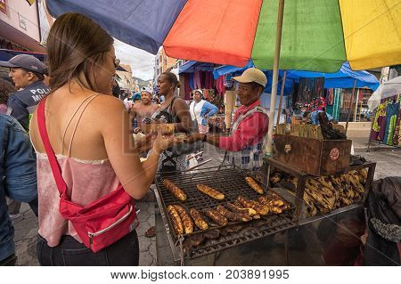 April 29 2017 Otavalo Ecuador: plantains baked on wood fire are popular food with locals as well as tourists in the Saturday market