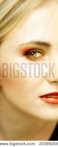 Woman with green eyes and striking bright make-up