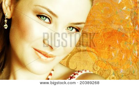 beautiful brunette close-up - on grunge background of my shapes and textures