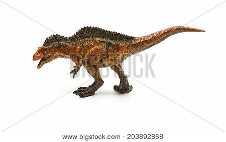 side view acrocanthosaurus toy on a white background