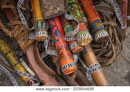 April 29 2017 Otavalo Ecuador: indigenous quechua crafts made of wood selling on the street in the Saturday market