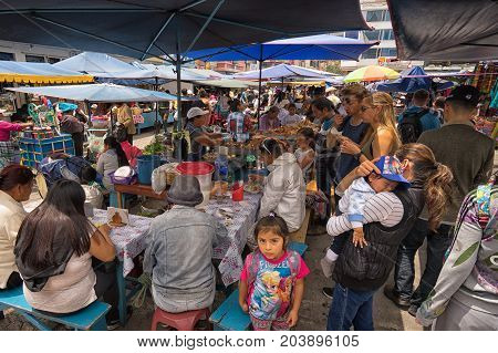 April 29 2017 Otavalo Ecuador: makeshift food stands equally popular with locals and tourists on the street in the Saturday market