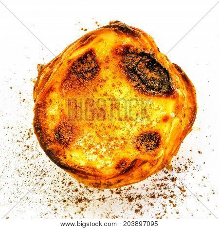Egg tart or portuguese egg tart isolated on white background macro. Beautiful delicious freshly baked tart bright colorful pastry little sweets