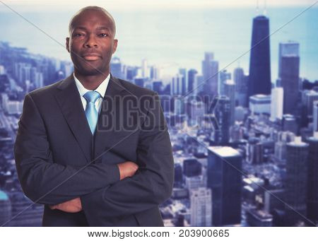 Smart african american businessman with skyline with skyline of city in background